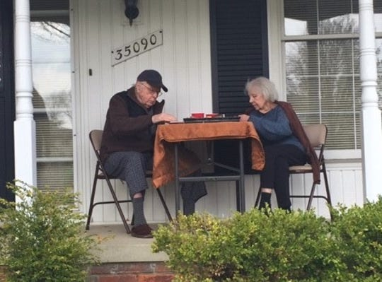 William and Sarah Niffin celebrating William's 93rd birthday with some pizza on April 28. Their family enjoyed pizza with them from a distance in their front yard.
