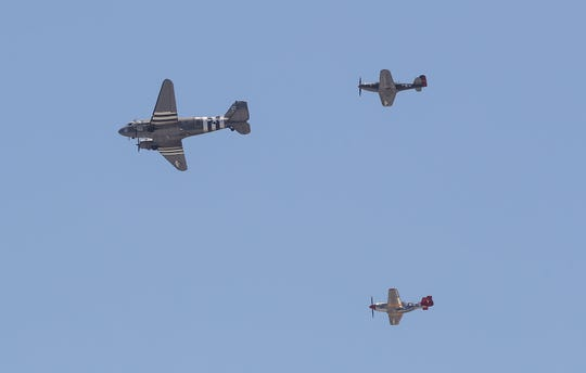 Three vintage warbird aircraft, a C-47 Skytrain, P-51 Mustang, and the P-63 Kingcobra, do a flyover in tribute to frontline hospital, police and essential workers in Palm Springs and Cathedral City, May 1, 2020.