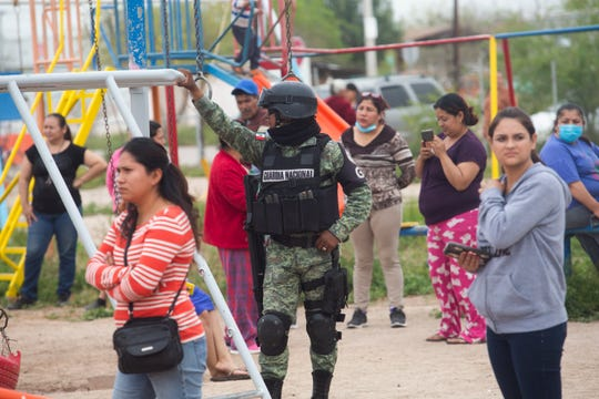 A Mexican National Guard oversees distribution of food to low-income communities in Mexicali during COVID-19 contingency in mid April.