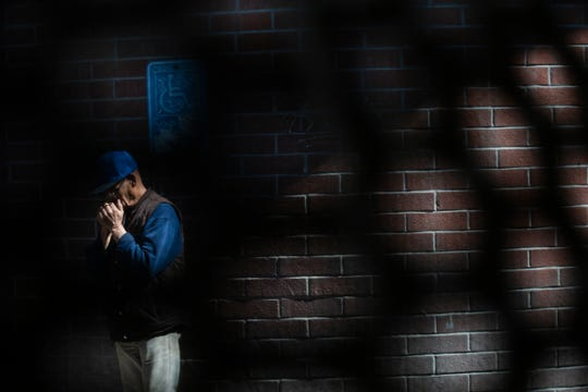"""A man waits for a family member to enter Mexicali, Mexico from Calexico, California at the West Calexico Port of Entry on March 20, 2020 as President Trump announced the intention to close the border only to """"essential"""" entry starting at 12:00 hours on March 21, 2020."""