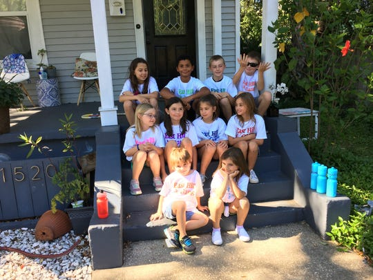 """The """"East Hill Gang"""" poses for a group picture.   Top row (from left to right) Maggie Comerford, 10, Mason Hill, 8, Patrick Frey, 9, Jude Poller, 11.  Middle row (from left to right): Rachel Frey, 7, Bridey Comerford, 8, Abby Cage, 8, Luca Poller, 7.  Bottom row (from left to right): Jimmy Comerford, 4, Morgan Frey, 6."""