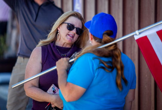 Republican state Rep. Kelly Townsend speaks with a protestor after a protest against Gov. Ducey's delay to reopen some businesses on May 1, 2020 in Apache Junction.