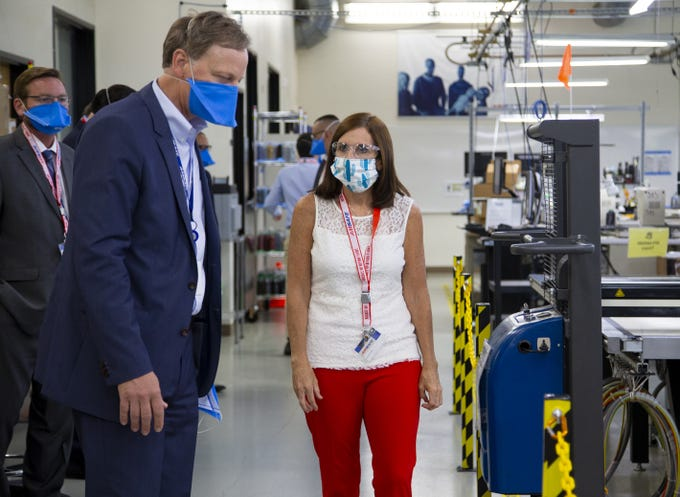 AMSafe director of engineering and quality, Shawn Bucher, gives Sen. Martha McSally a tour of the plant on Friday, May 1, 2020. The company makes seatbelts for airlines but has converted some of its production to PPE during the pandemic.