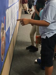 Students at Westwind Elementary School in Phoenix rush on Mondays to check if teacher Tim Ramsey posted their writings on the wall outside his classroom.