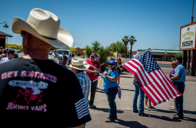 People protest against Gov. Doug Ducey's delay to reopen some businesses on May 1, 2020 in Apache Junction.