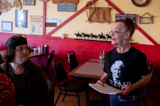 Debra Thompson tells customers that she will keep her restaurant open after Wickenburg police officers informed her that she needed to close and comply with Gov. Doug Ducey's statewide order on May 1, 2020, at Horseshoe Cafe in Wickenburg.