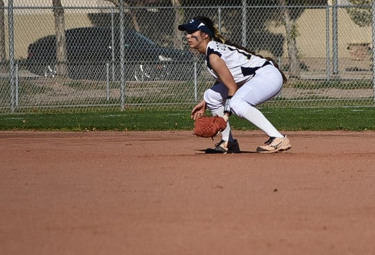 Raymond Kellis shortstop Lexy Macias gets in position infield during a game.