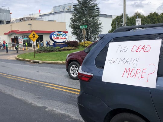 A procession of cars drove past the Bell & Evans plant several times Friday morning to demand its shutdown. Attempts to reach the company were unsuccessful Friday.