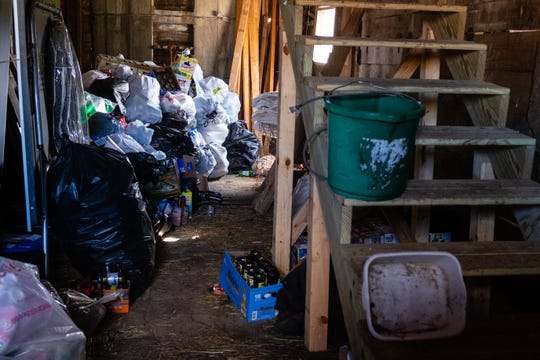 Recyclables are stored in bags in one of the barns at Day Dreams Farm in Cottrellville. Lisa Ponke, who owns the farm, says recyclables are one of the ways her non-profit rescue gets income.