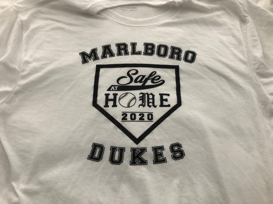 "Marlboro baseball coach John Morrissey met with players this week to distribute ""Safe at Home"" t-shirts as a safety reminder to his team during the COVID-19 crisis."