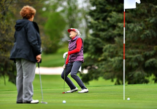 Janet Masters, left, looks on as Dorothy Devilbiss, of Fawn Township reacts after missing a put on the 17th green at Briarwood East Golf Course in West Manchester Township, Friday, May 1, 2020. Dawn J. Sagert photo