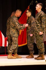 Maj. Gen. Karsten Heckl (left), commanding general, 2nd Marine Aircraft Wing, presents Staff Sgt. Leary Reichart-Warfel with the Navy and Marine Corps Medal aboard Marine Corps Air Station Cherry Point, North Carolina, January 28, 2019. Reichart Warfel received this award for his heroic efforts while saving a family at Atlantic Beach, North Carolina. (U.S. Marine Corps photo by Staff Sgt. William L. Holdaway)