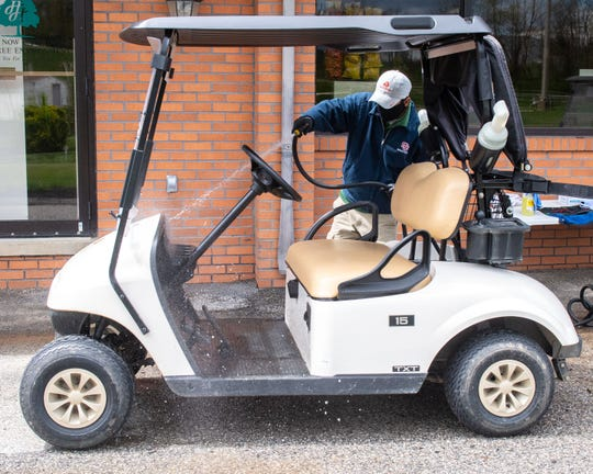 After golfers return their carts, Heritage Hills staff washes off and disinfects each vehicle, May 1, 2020.