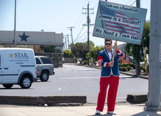 Salinas resident Michael Lipe, 45, wears a red, white and blue outfit during the freedom rally event at the corner of Blanco Road and S. Main Street on Friday, May 1, 2020.