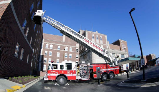 An aerial fire truck from the Town of Sheboygan helped make visits to former Town of Sheboygan fire chief Kenneth Gumm possible, Thursday, April 30, 2020, at Aurora Sheboygan Memorial Medical Center, in Sheboygan, Wis.