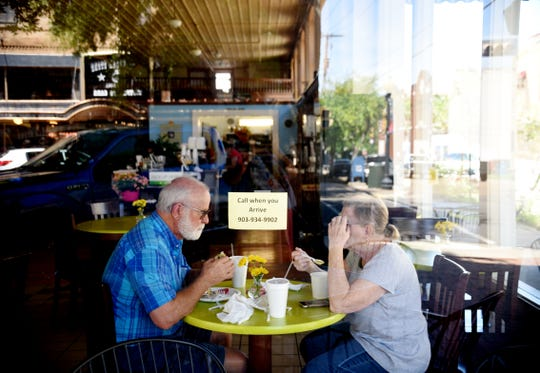 People eat inside a restaurant on North Washington Ave. in Marshall, Texas.
