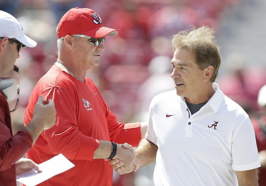 Jeff Tedford, left, shaking hands with Alabama coach Nick Saban, retired from Fresno State after the 2019 season.
