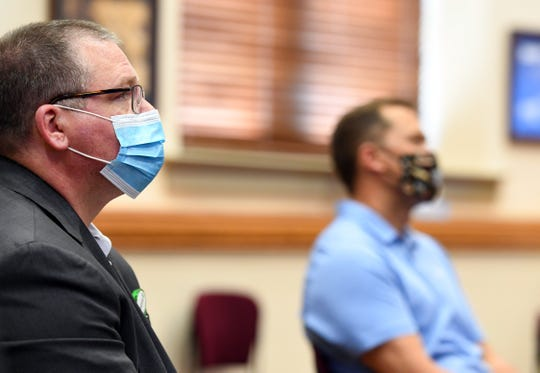 Avera representative Dr. Mike Elliot and Sanford representative Dr. Mike Wilde wear face masks while listening as city councilors go over the first reading of the proposal to ease occupancy restrictions in businesses on Friday, May 1, at Carnegie Town Hall in Sioux Falls.