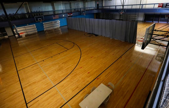 One of the gyms at the Pat Jones YMCA remains dark as the limited staff prepares to reopen the facility.