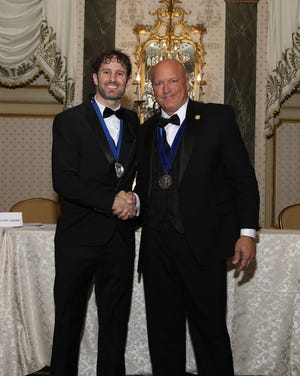 Dr. Tim Hiesterman accepting the AOAO award from Dr. Joesph D. DiCicco.