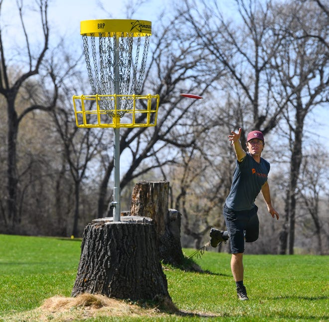 Cale Leiviska makes a short shot Monday, April 27, 2020, at the Airborn Disc Golf Preserve in Clearwater. Leivska is ranked 21st in the world for disc golfing. He recently purchased and opened the new course.