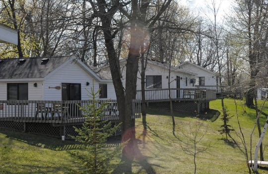 Cabins are ready for summer vacationers at Riverside Resort on Cedar Island Lake in Richmond.