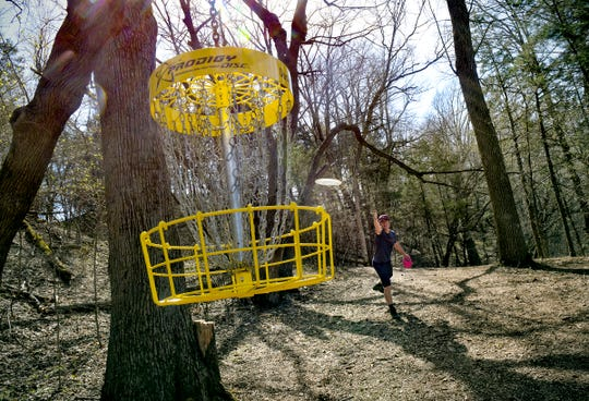 Cale Leiviska takes a shot at a hanging basket on the course Monday, April 27, 2020, at the Airborn Disc Golf Preserve in Clearwater. Leviska is ranked 21st in the world for disc golf according to the Professional Disc Golf Association. He recently purchased the course near Clearwater and opened it for disc golfing this spring.