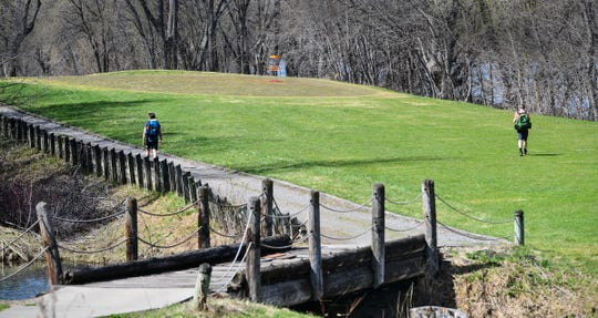 Golfers make their way toward a green nestled between a small stream and the Mississippi River Monday, April 27, 2020, at the Airborn Disc Golf Preserve in Clearwater.