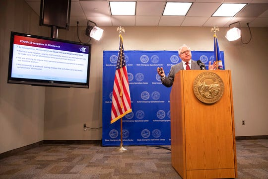 Minnesota Gov. Tim Walz speaks at a news conference inside the Department of Public Safety in St. Paul on Thursday, April 30, 2020.