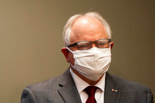 Gov. Tim Walz's glasses fog up as he wears a mask during a news conference inside the Department of Public Safety in St. Paul on Thursday, April 30, 2020.