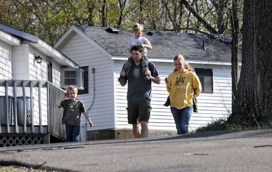 Joe DeRose walks with his wife, Christina, and their children in this 2015 file photo taken at Riverside Resort on Cedar Island Lake in Richmond.