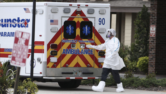 Emergency personnel prepare to transport a patient by ambulance from the Freedom Square Seminole Nursing Pavilion in April. At least eight residents of the Seminole retirement community have died from the novel coronavirus. [DIRK SHADD / Times]