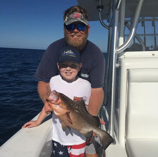 Capt. Patrick Price and son Zane of Jensen Beach fish aboard DayMaker charters out of Sailfish Marina in Stuart.