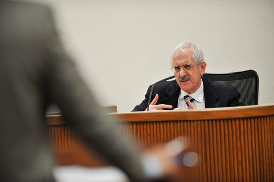 Chief Medical Examiner Dr. Roger Mittleman gives testimony on Blake Hadley's autopsy during the second day of Tyler Hadley's sentencing hearing at the St. Lucie County Courthouse in Fort Pierce on March 11, 2014.  The murders of Blake and Mary-Jo Hadley occurred July 16, 2011 in Port St. Lucie. Their son Tyler Hadley was convicted of the murder.