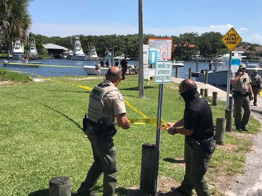 Officials set up yellow police tape on Friday, May 1, 2020 after  a man reportedly fell overboard about 8 miles off the St. Lucie Inlet.