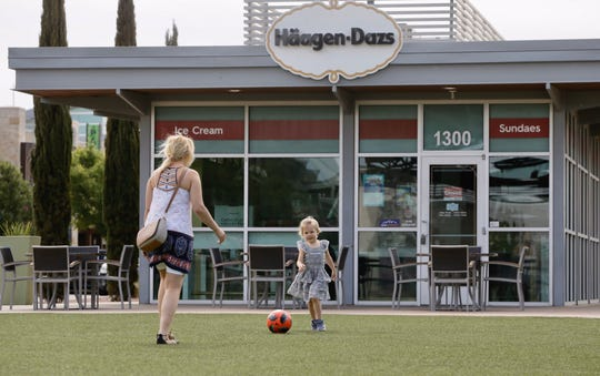 A mini soccer game picks up Friday at a Haagen-Dazs near Fountains of Farah.  Texas Gov. Greg Abbott loosened restrictions on businesses Friday, allowing retail stores, shopping malls, movie theaters and restaurants to reopen at 25% capacity.