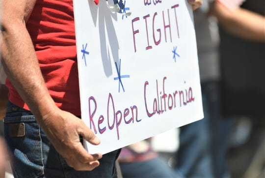 Nearly 300 people rallied at the corner of Mooney Boulevard and Caldwell Avenue urging Gov. Gavin Newsom to reopen the state.