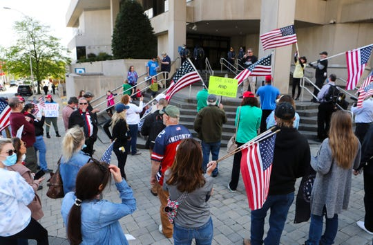 Reopen Delaware holds a rally to urge the easing or removal of coronavirus-related restrictions at the Carvel State Office building Friday.
