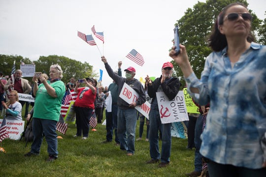 Members of the Facebook group Delawareans Against Excessive Quarantine and protesters rally to reopen Delaware on the green next to Legislative Hall Friday, May 1, 2020, in Dover.