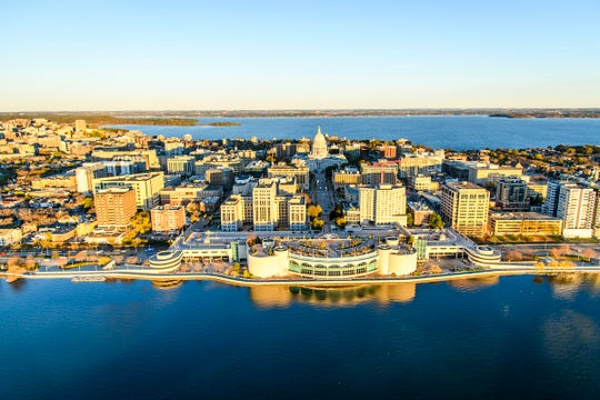 Lake Mendota and Lake Monona, along with the downtown Madison Isthmus and Wisconsin State Capitol, are pictured in an early morning aerial taken from a helicopter on Oct. 23, 2018.