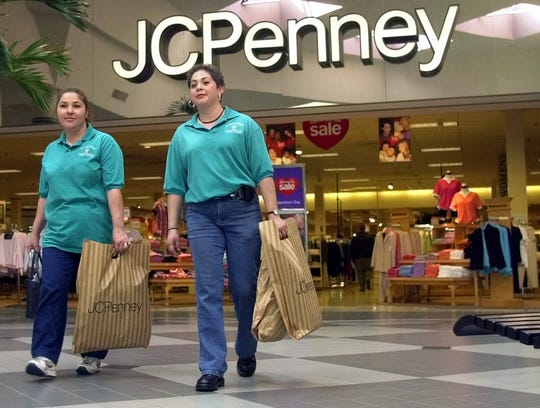 Sara Palomares, right, and an unidentified woman leave the J.C. Penney store in Irving, Texas, on Jan. 25, 2001.