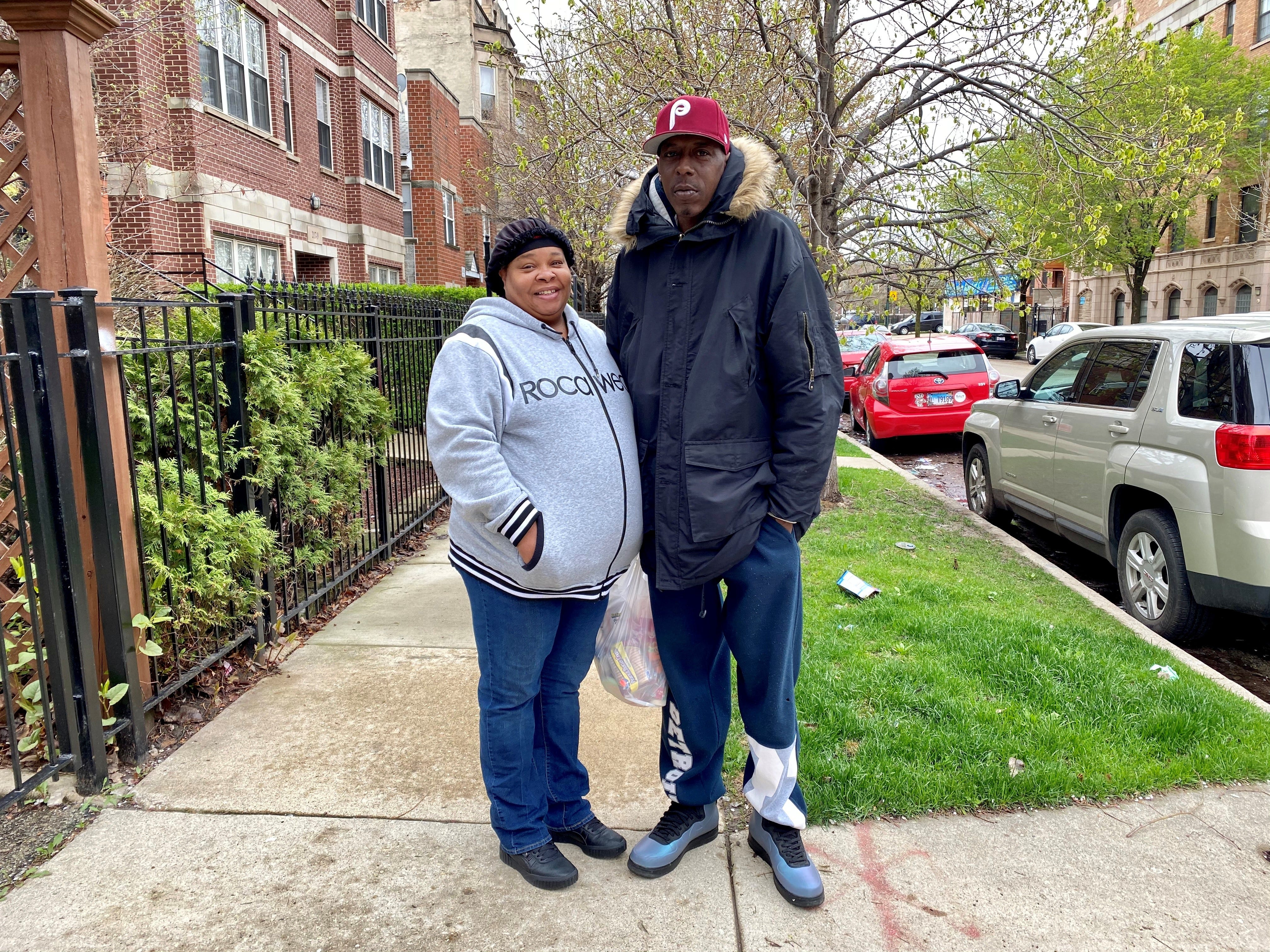 East Garfield Park residents Jimmy and Rachel Walker head home from the market in Chicago, Ill. on April 30, 2020.