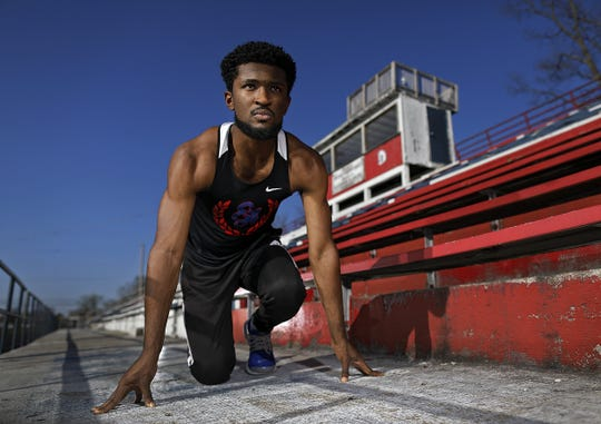 Eastmoor Academy track star Ira Graham IV poses for a photo at Eastmoor Academy High School Stadium in Columbus, Ohio on April 8, 2020.  Graham lost his spring track season due to the coronavirus.