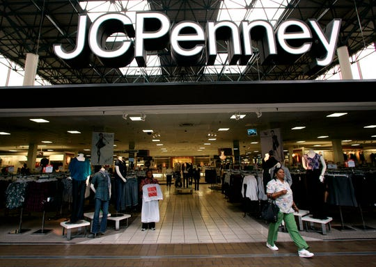 A customer leaves a J.C. Penney store in Tallahassee, Fla., on Tuesday, Sept. 1, 2009.