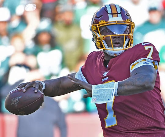 Washington Redskins quarterback Dwayne Haskins attempts a pass against the Philadelphia Eagles during the first half at FedExField.