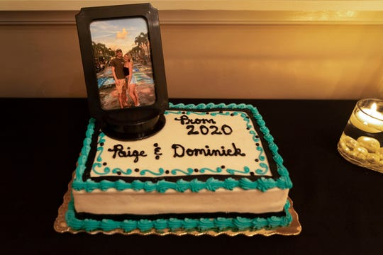 April 18, 2020: Royal Palm Beach, FL, USA The cake for Paige Houck and Dominick Grosso as they celebrate their prom at the Grosso home. Their school prom was cancelled because of the coronavirus.