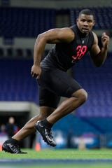 Syracuse defensive lineman Alton Robinson runs a drill at the NFL football scouting combine in Indianapolis. In Darrell Taylor and Alton Robinson the Seattle Seahawks believe they could have their pass rushers of the future.