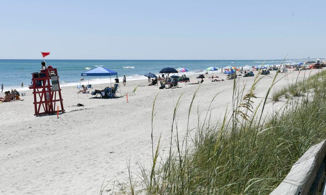 Beachgoers enjoy the weather at Howard E. Futch Memorial Park at Paradise Beach in Indialantic in May.