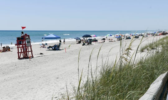 Beachgoers enjoy the weather in Howard E. Futch Memorial Park at Paradise Beach in Indialantic Saturday, May 2, 2020 after the park reopened to visitors.Mandatory Credit: Craig Bailey/FLORIDA TODAY via USA TODAY NETWORK