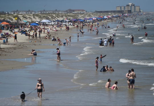 Beach-goers crowd Whitecap Beach near Bob Hall Pier at 3 p.m., Saturday, May 2, 2020.